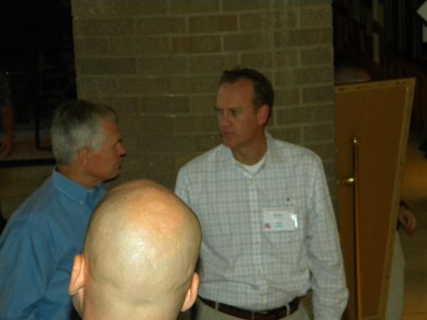Utah county chair Taylor Oldroyd talks with Pau Ure