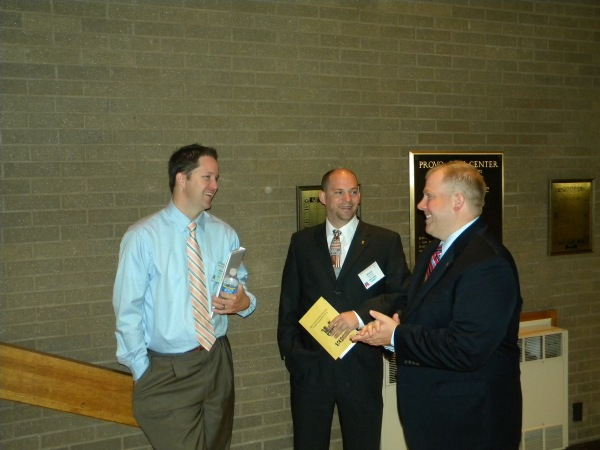 Vice-chair Morgan Philpot speaks with Daniel Thatcher and Randy O'Hara