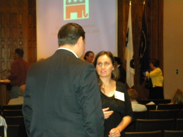 Utah County GOP secretary Lisa Shepherd talks to SL County secretary Kurtis Constantine